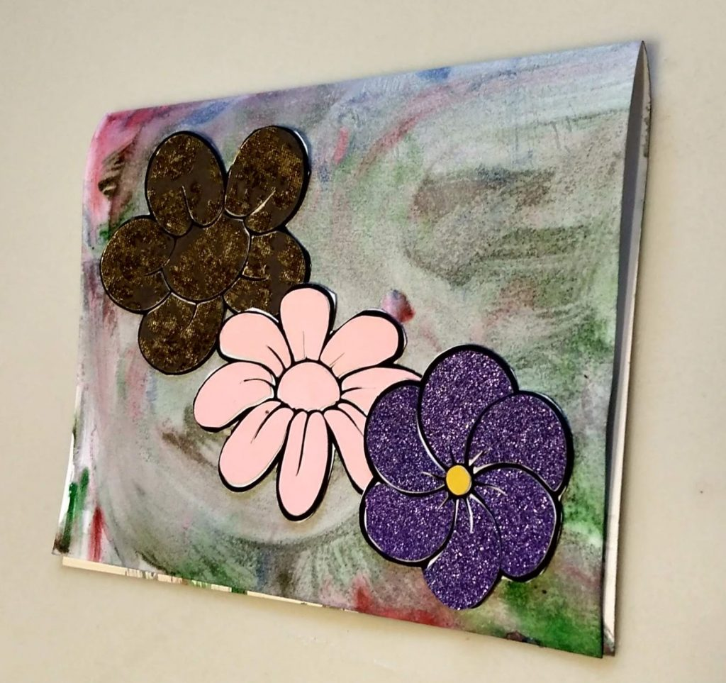 Card using 3 of the coloring with paper flowers