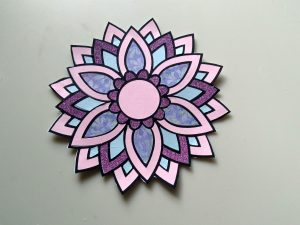 Pink Flower Mandala made by coloring with paper