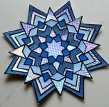 Blue Star Mandala made by coloring with paper