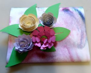 Card with rolled flowers
