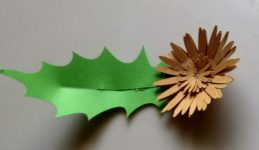 the Gerber Daisy paper flower with leaves in brown