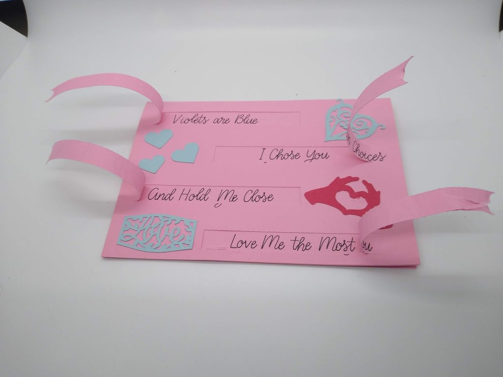 Front of perforation valentines card with tabs pulled