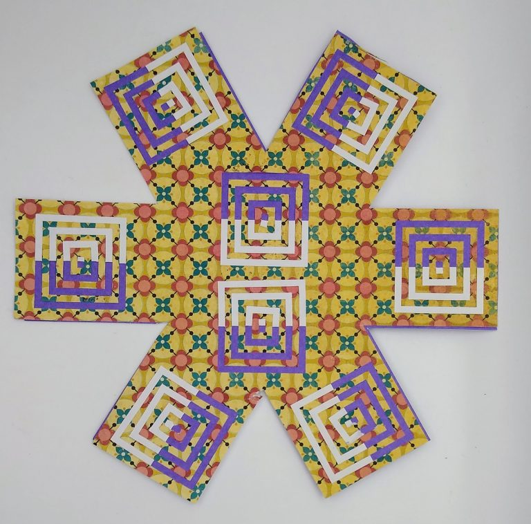Incire Cross made with a yellow patterned paper