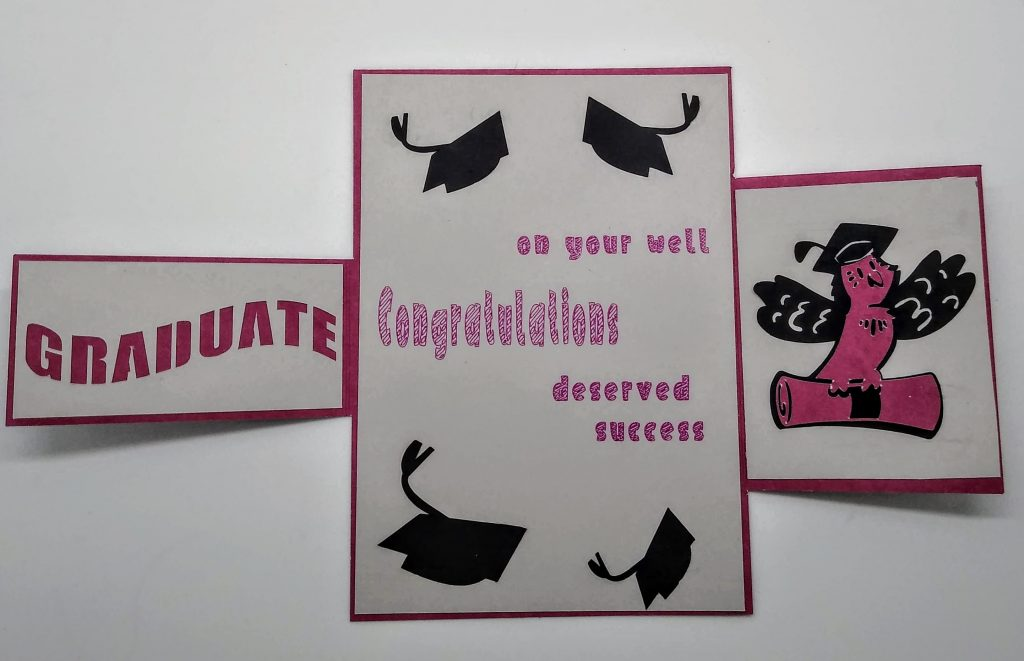 Altered gatefold graduation card in red and grey open