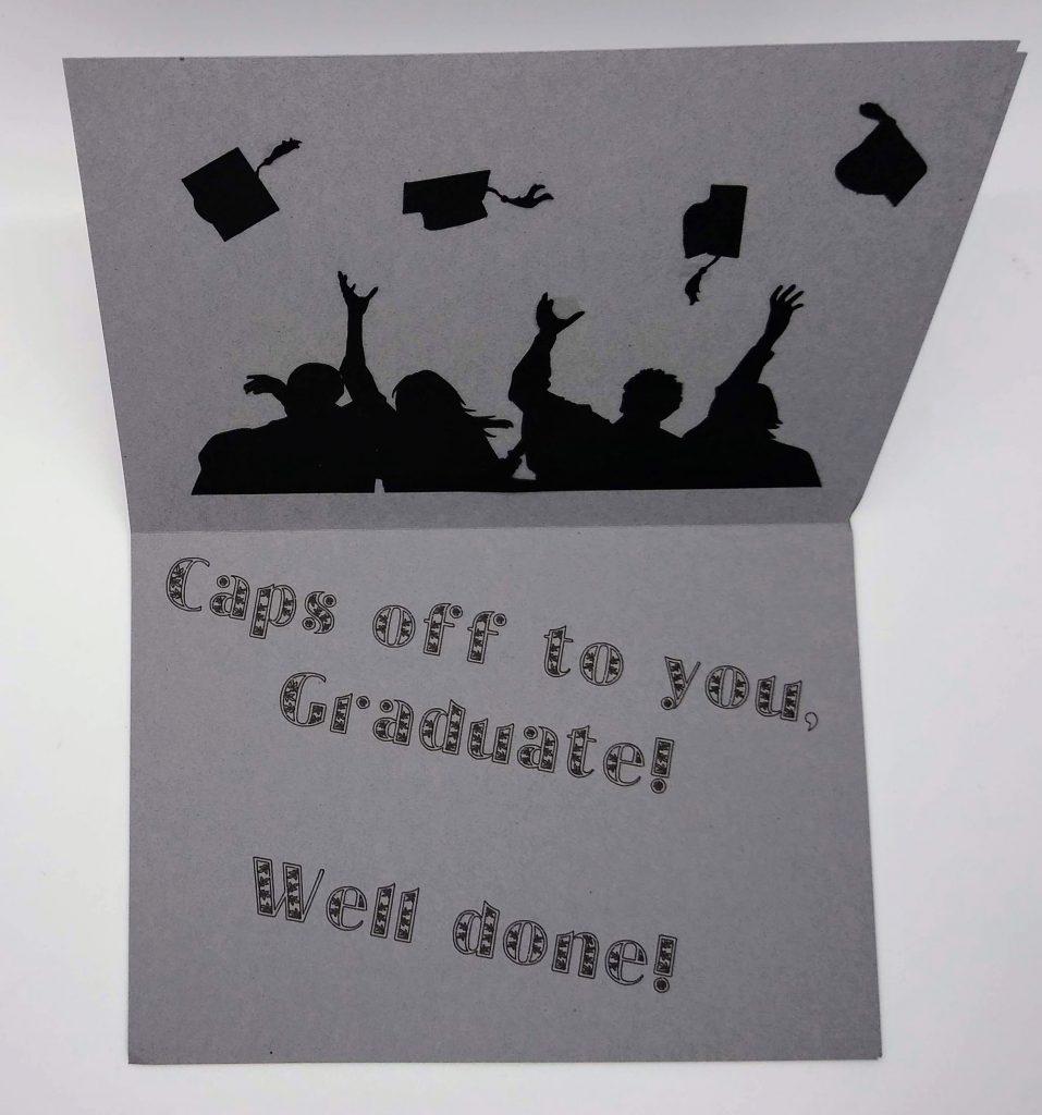 Inside caps off graduate card