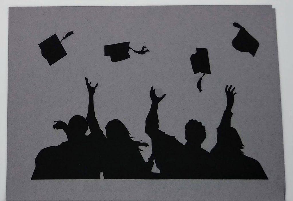 Caps off graduate card top close up