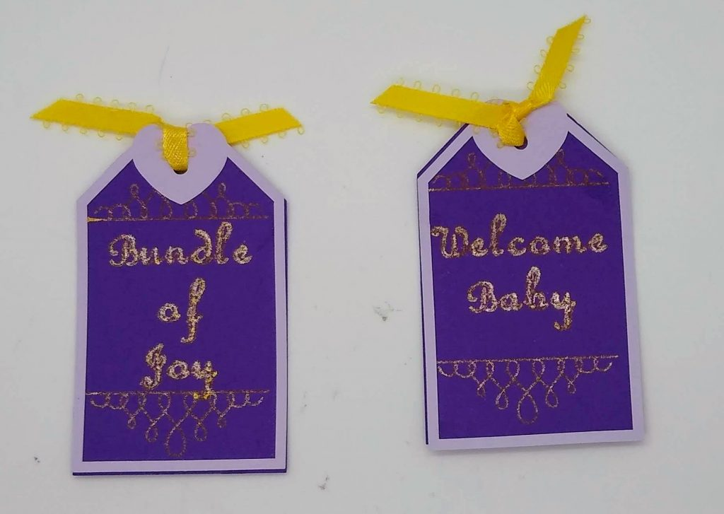 tags tucked into the pockets of the two pocket baby card