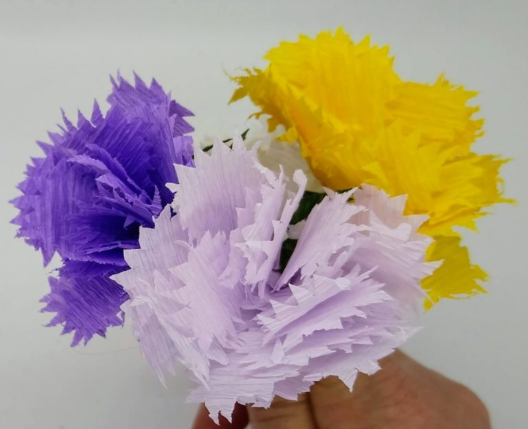 Crepe paper carnation flowers in several colors