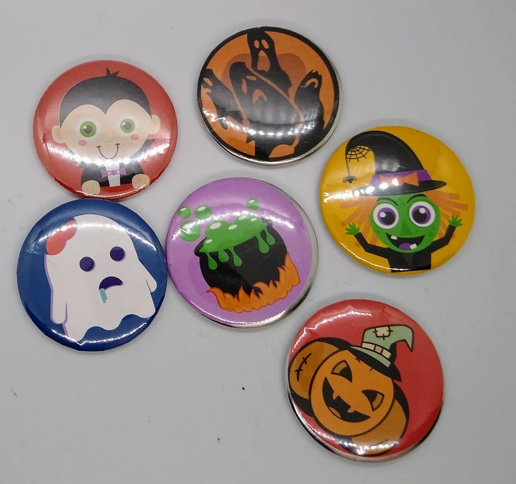 Make buttons or stickers. These are Halloween Designs