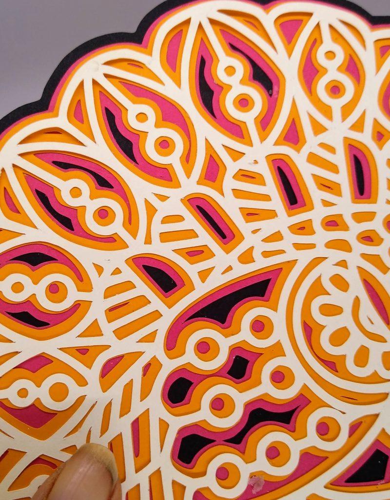Close up details of the layered turkey mandala