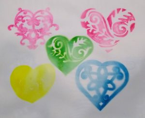Infusible Ink pens used to color in hearts