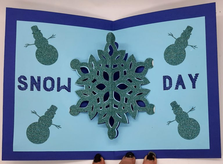 Inside of snow days card laying flat